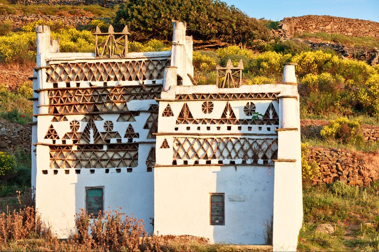 Morning light falling on a traditional dovecote on Tinos Island, Greece
