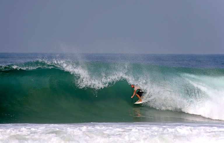C68W3N Surfing deep in the tube of a powerful wave. Puerto Escondido, Oaxaca, Mexico, North America