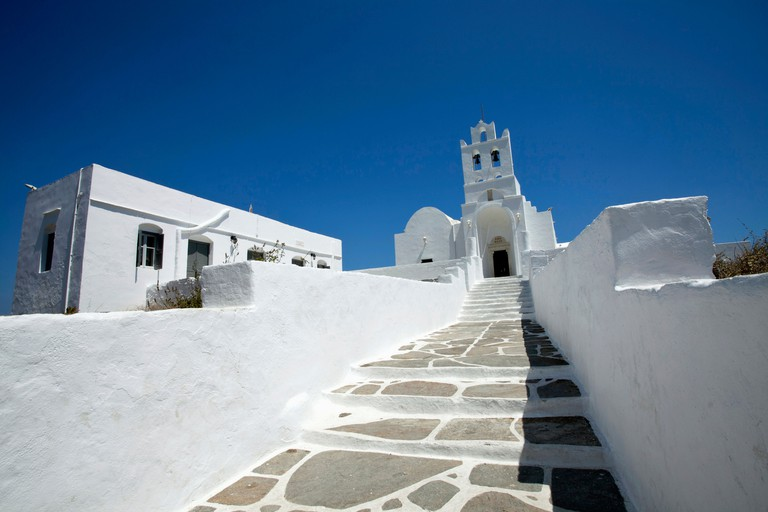 Sifnos Island Landscape format low angle photograph of the church inside Chrissopigi monastery which is build on the top of a