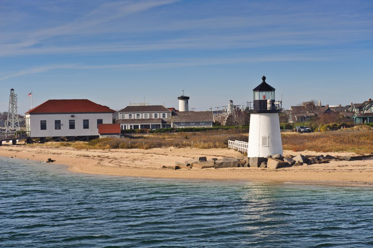 Brant Point Lighthouse at the entrance to Nantucket Harbor The 26 foot tall white wooden lighthouse is the lowest in New England