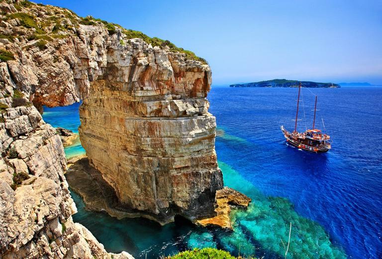 "DA169W Trypitos (""Kamara""), a natural rocky arch at Paxos island, Greece"