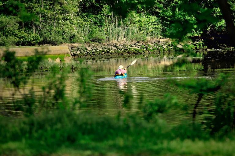 Woman kayaking Stony Brook Long Island New York