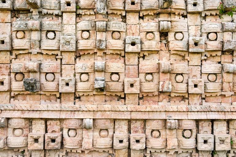Close up of the wall at the Mayan ruins at El Palacio de los Mascarones (Palace of Masks), Kabah, Yucatan, Mexico, North America