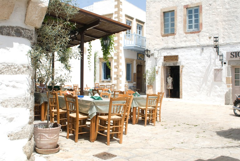 A village square view of Chora (Hora) the capital of Patmos Island, Greece