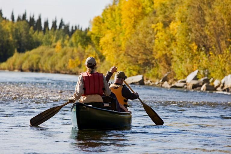 Men rowing a canoe,