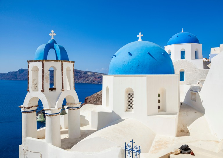 White churches and blue domes in the village of Oia, Santorini, Thira, Cyclades Islands, Greek Islands, Greece, EU, Europe