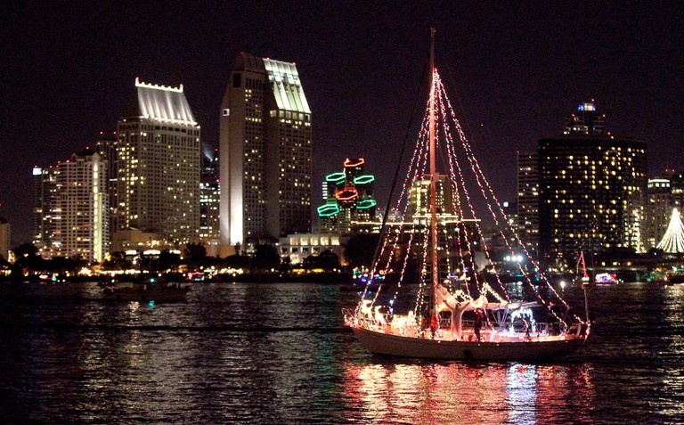 Dec. 14, 2014 - San Diego, California, United States - December 14, 2014_Coronado, California_USA_  A boat in the annual San Diego Bay Parade of Lights passes by Coronado near the end of the Parade's route with the downtown San Diego skyline in the distan