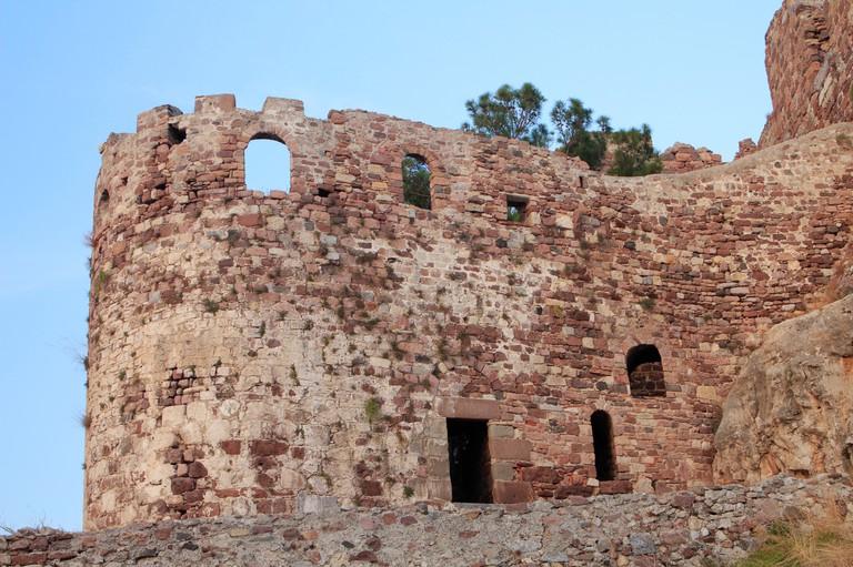 Closeup of the stone-built walls of Mytilene medieval castle. Lesvos island, Greece