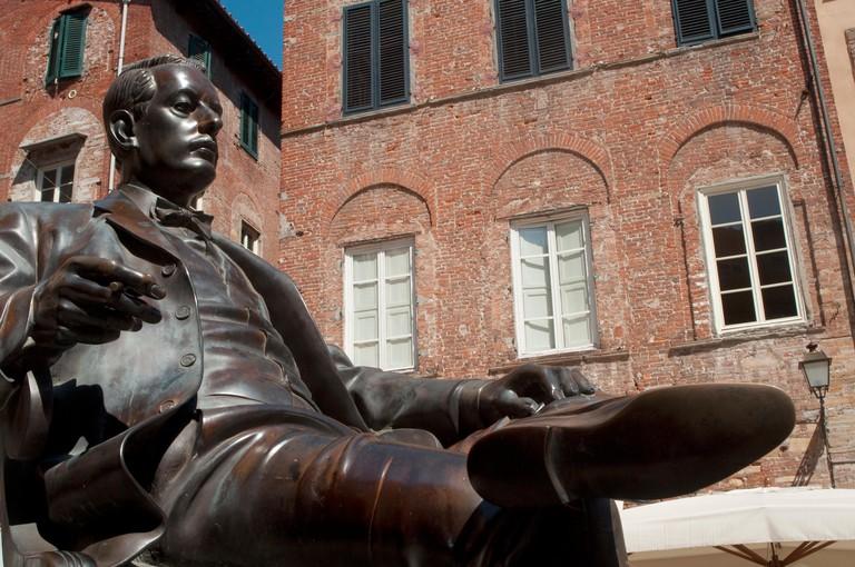 Italy, Tuscany, Lucca, Bronze Statue of Giacomo Puccini in Cittadella Square by Vito Tongiani
