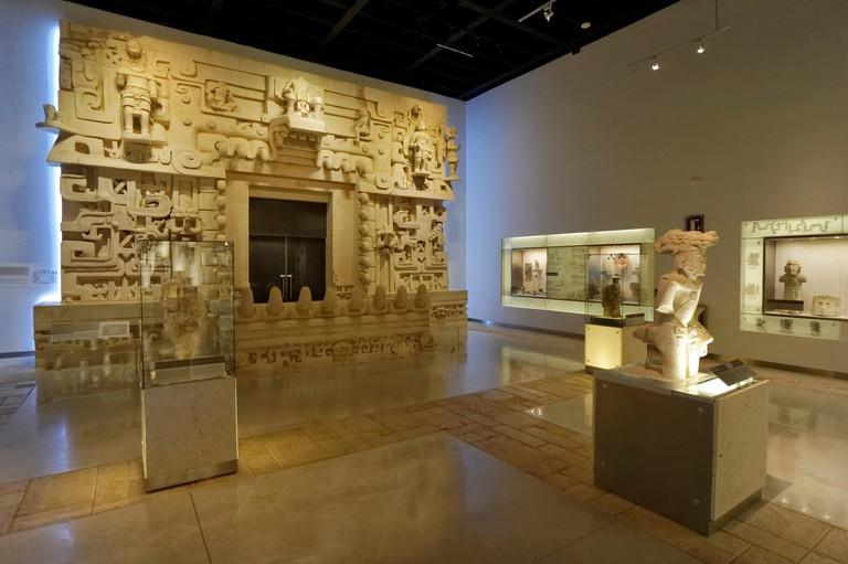 Gallery with archaeological artifacts and replica of royal  Mayan tomb at Ek Balam, Gran Museo del Mundo Maya, Merida, Yucatan