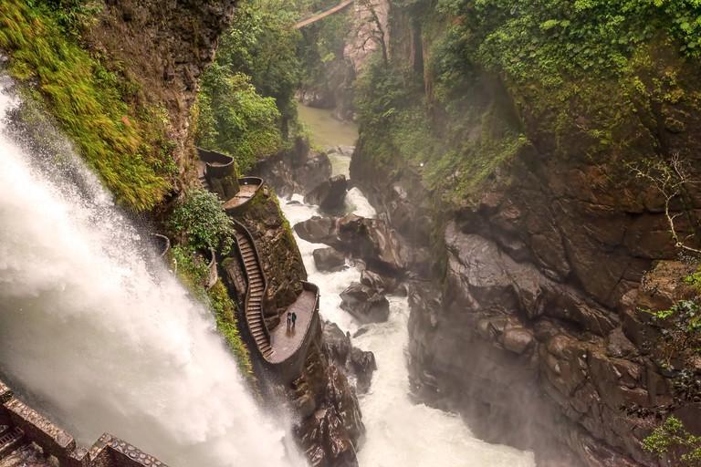 Pailon Del Diablo, Devils Cauldron A Waterfall Atop A Mountainous Range That Falls Below A Deep Canyon