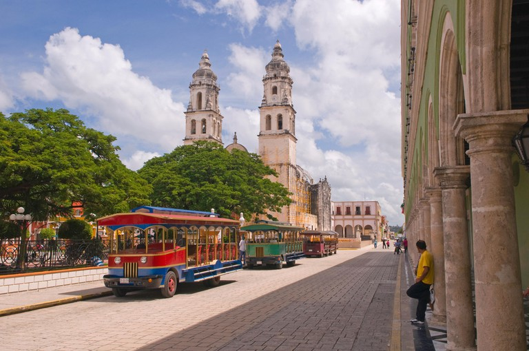 Trolley buses in the plaza (square) in San Francisco de Campeche, Mexico, South America