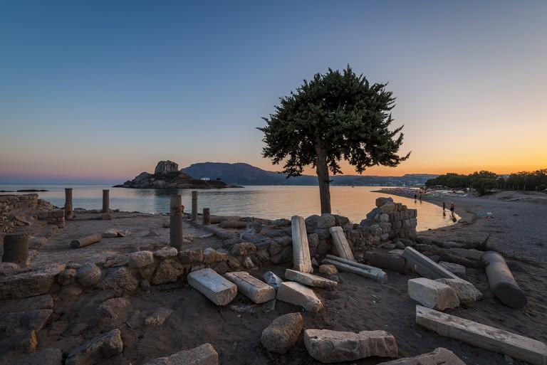 Summer sunset in Kefalos Agios Stefanos beach