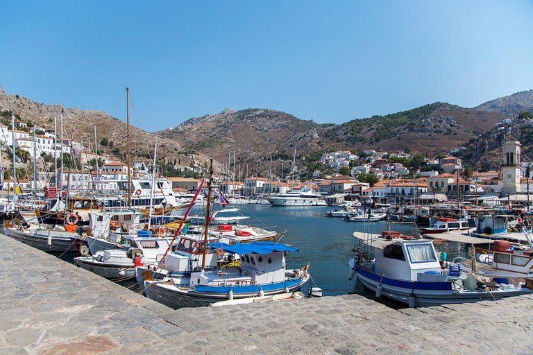 HYDRA, GREECE - AUGUST 29, 2016: Boats at town Hydra on Hydra island in Greece. Hydra is one of the Saronic Islands of Greece.