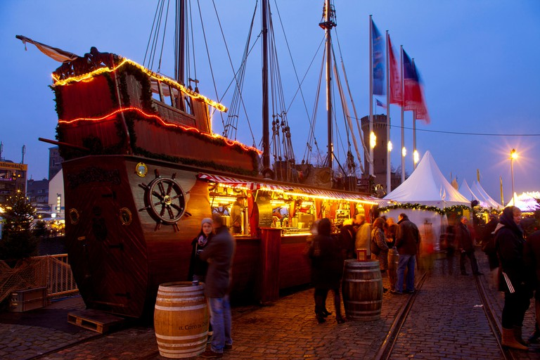Germany, Cologne, the Christmas market at the Rheinau harbor between the Chocolate Museum and Malakoff Tower