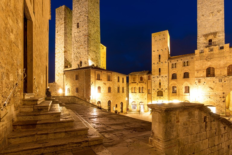 HFPKWR Piazza del Duomo and towers of San Gimignano at twilight, Tuscany, Italy
