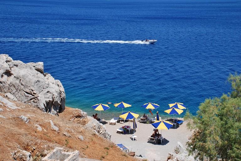 Looking down onto Nos beach near Yialos on the Greek island of Symi.