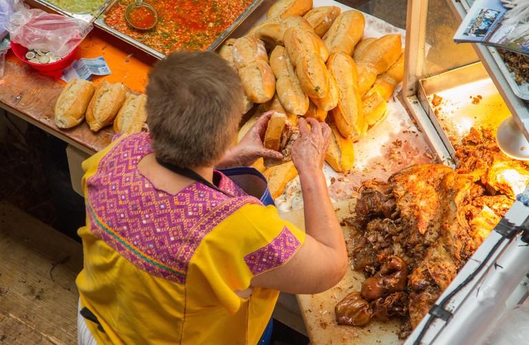 HY9137 Mercado Hidalgo has been in operation since 1910. Assembling a guacamaya sandwich