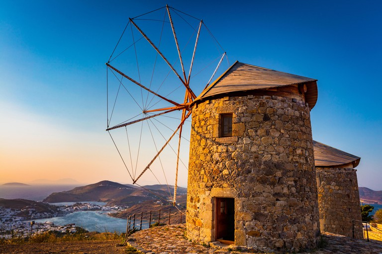 Windmills on the Greek island of Patmos. Patmos is a small Greek island in the Aegean Sea, most famous for being the location of both the vision of an