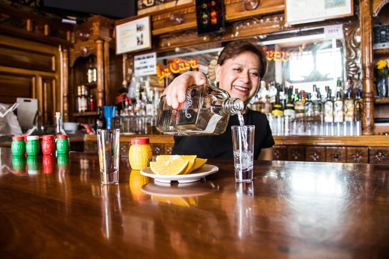 JCRC67 Bartender pouring a shot of mezcal, La Casa del Mezcal - Oaxaca, Mexico