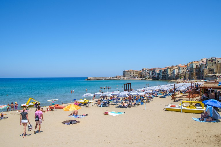 The beach and the Old Town in Cefalu, Sicily. Historic Cefalu is a major tourist destination on Sicily.