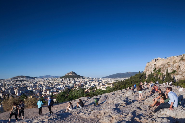 Greece, Central Greece Region, Athens, sunset visitors to Areopagus Hill