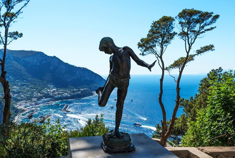 bronze sculpture of a fisher boy at villa lysis capri, italy, home of jacques d?adelsward-fersen.