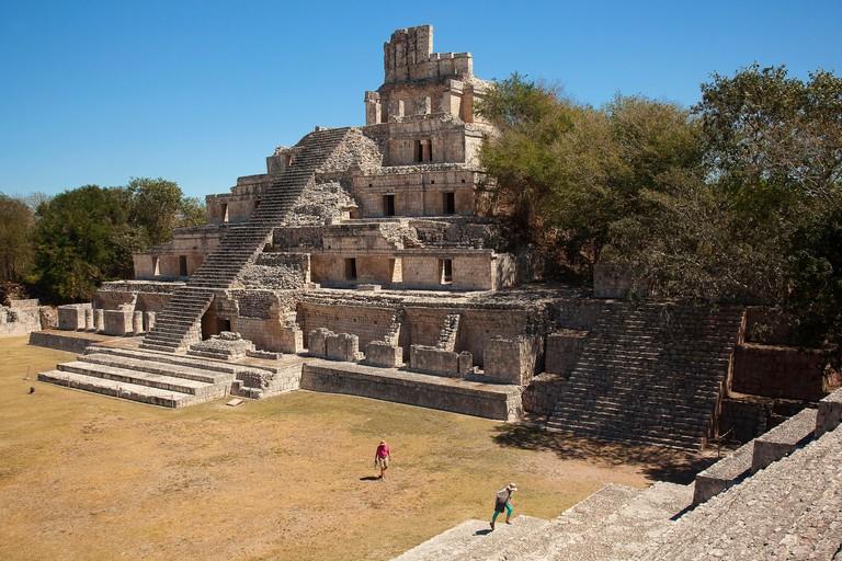 Visitors in front of the Edificio de los Cinco Pisos building at Gran Acropolis in Edzna Mayan Archeological site, Campeche State, Mexico, Central