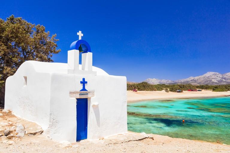 KWF6WA Traditional white church by beach of Agia Anna, Naxos island, Cyclades, Greece