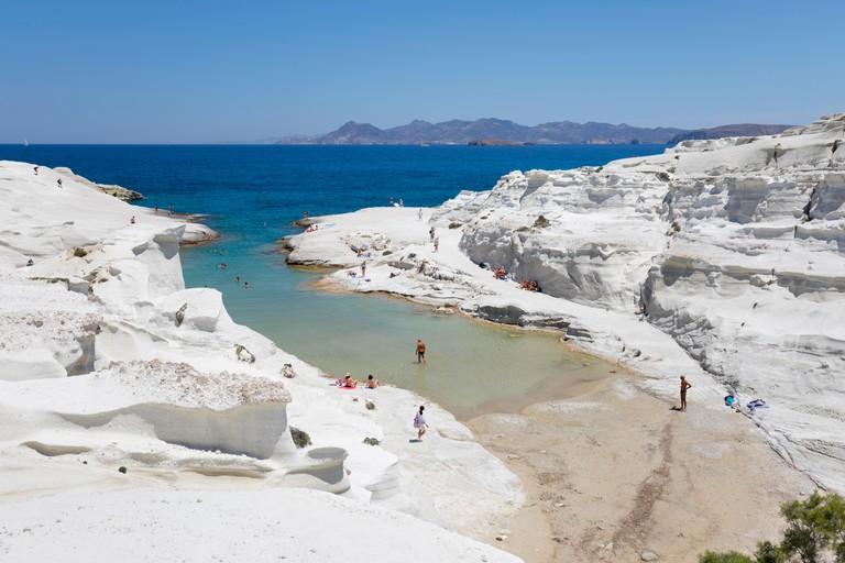 Beach and volcanic rock formations at Sarakiniko on north coast, Sarakiniko, Milos, Cyclades, Aegean Sea, Greek Islands; Greece; Europe
