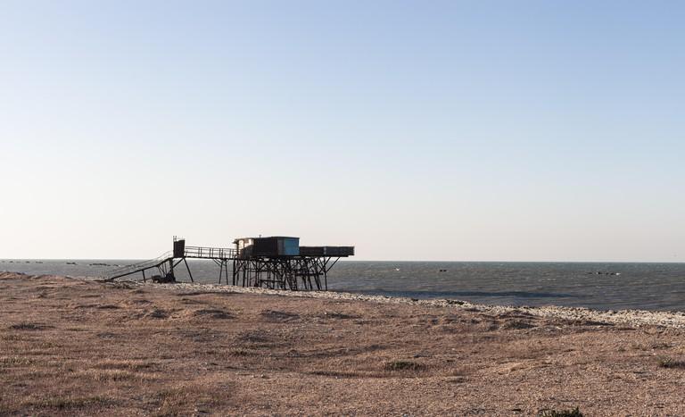 Beautiful surreal landscape of abandoned house at Caspian Sea, Azerbaijan, Novkhani