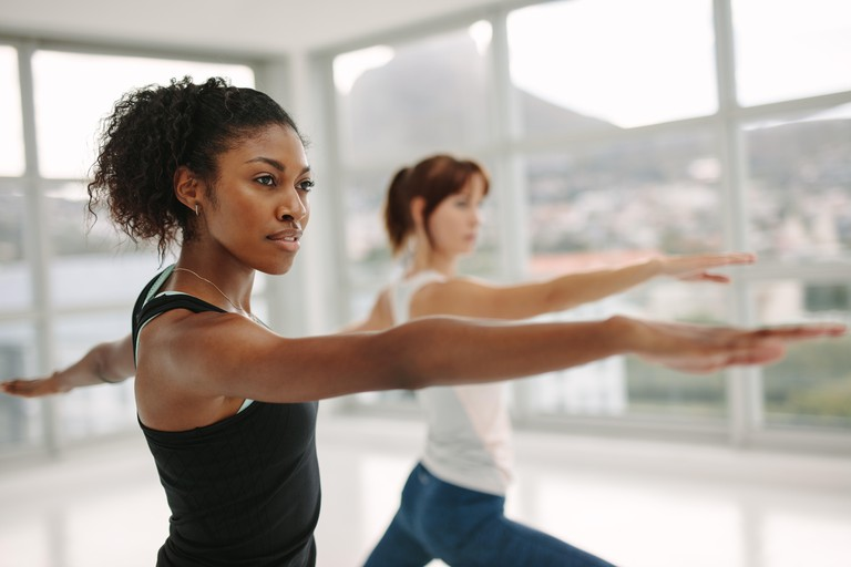 Woman stretching her arms at class