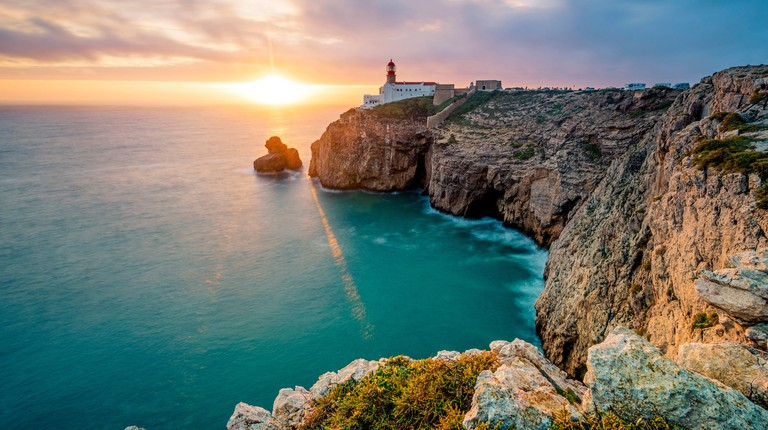 Cabo de Sao Vicente (Cape St. Vincent) , Sagres, Algarve, Portugal. The southwesternmost lighthouse in Europe at sunset.