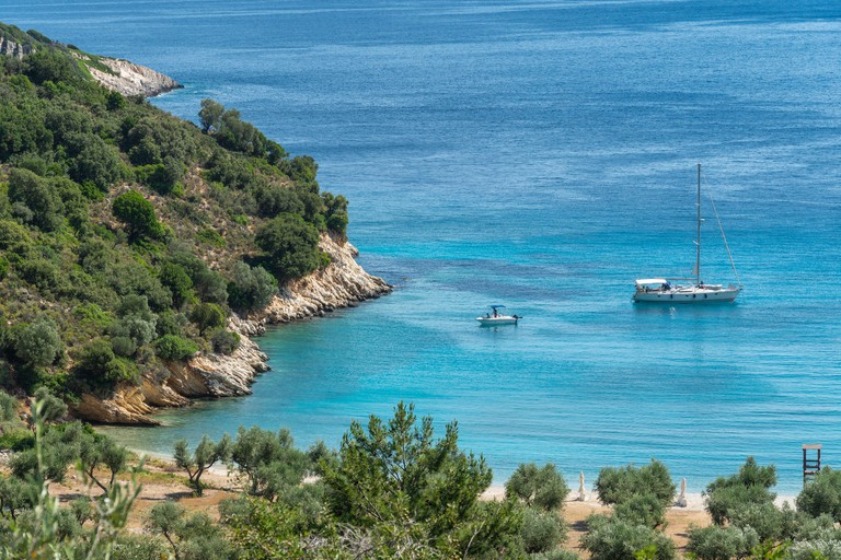 Yacht at anchor at Filiatro beach. On the East coast of the island of Ithaca, Ionian Sea, Greece. P965HX