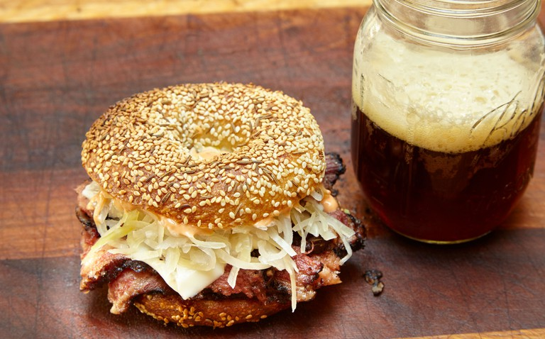 Daily River SF. Pastrami-on-Caraway-Sesame-with-sauerkraut-and-a-beer-credit-Frankie-Frankeny