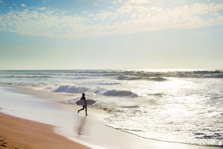 Surfing in the Atlantic ocean. Algarve, Portugal
