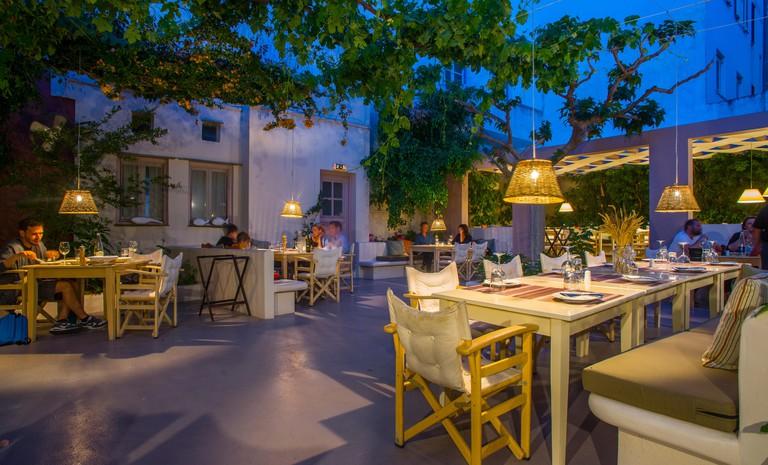 europe, greece, cyclades, tinos, island, town, itan ena mikro karavi, restaurant, bar, food