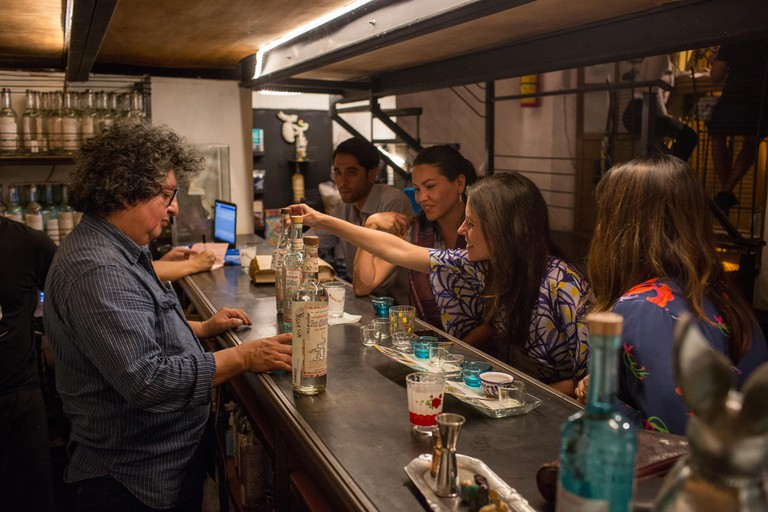 Ulises Torrentera, left, serves mezcal at his bar OMezcaler?a In SituO, in Oaxaca, Oaxaca, Mexico, November 6, 2017. Mezcal is a traditional Mexican drink that is recently surging in popularity.