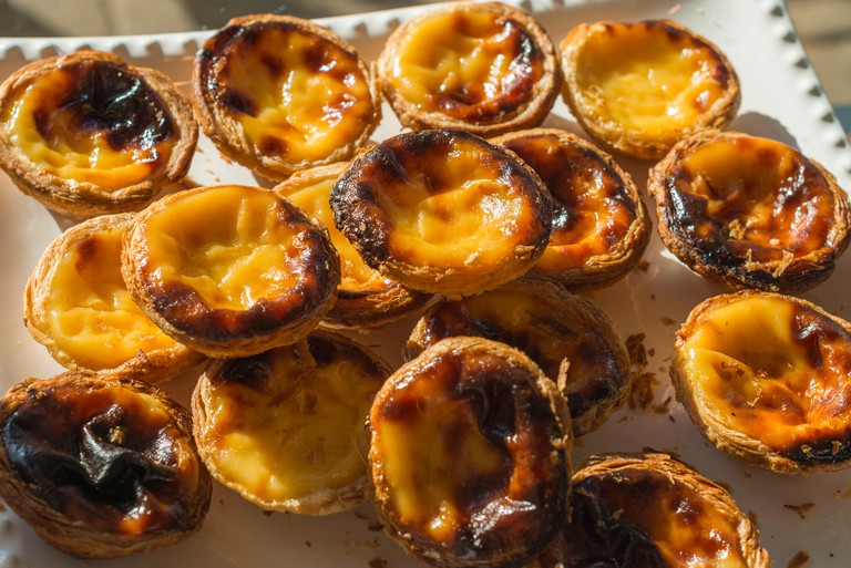 Pastel de nata is a Portuguese egg tart pastry dusted with cinnamon.