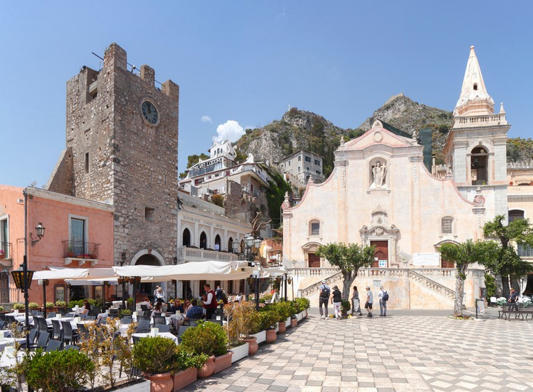 Piazza IX Aprile, Corso Umberto (main street), Church of San Giuseppe, Torre dell'Orologio Gate, Taormina, Province of Messina, Sicily, Italy, Europe