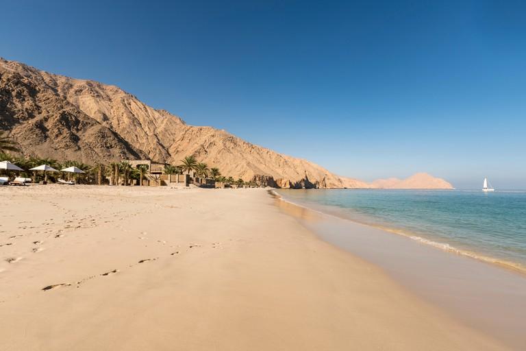 MUSANDAM, OMAN - NOVEMBER 18, 2016: The beach at Zighy Bay in the Omani enclave of Musandam