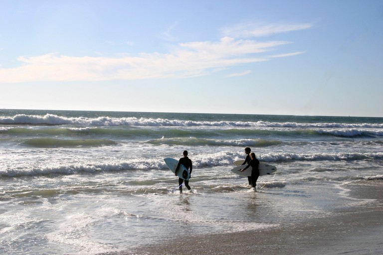 Surfers at the Pacific Ocean in California, USA