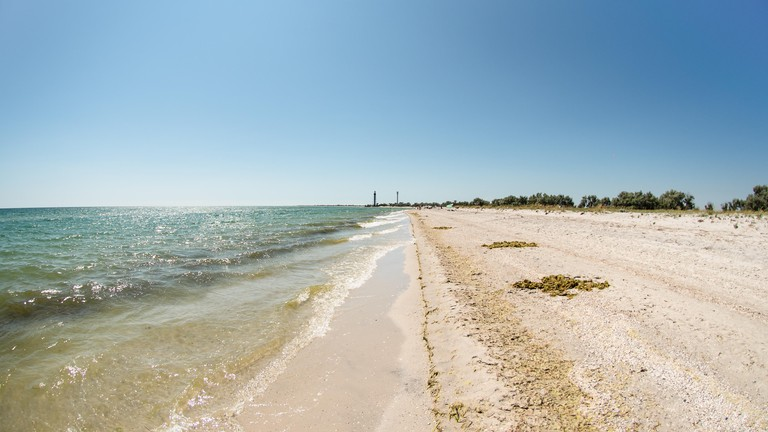 Coast of Dzharylhach island it the Black Sea, Ukraine. Two lighthouses far away