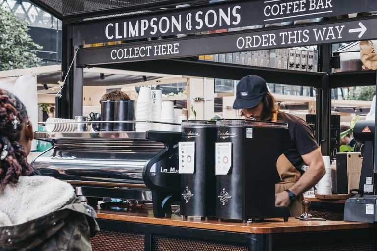 People order coffee at Climpson & Sons stand inside Spitalfields Market