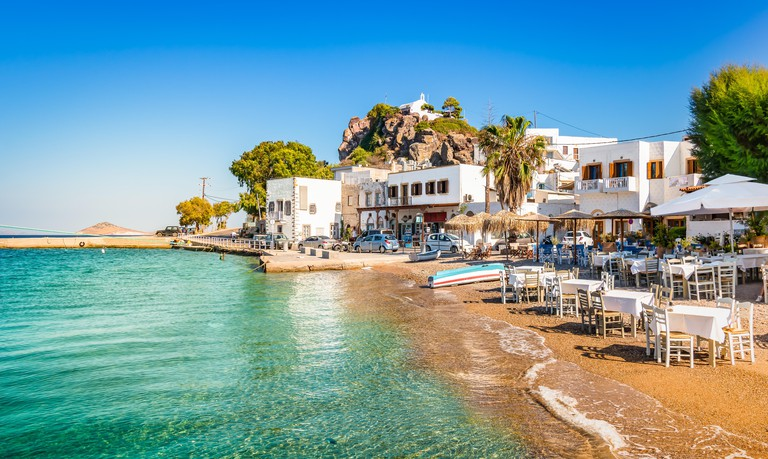 Patmos Island, Greece. Skala village and harbor view with beach at the port