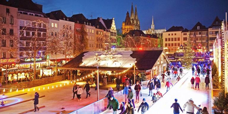 People on the illuminated ice rink on the Heumarkt, Cologne, North Rhine-Westphalia, Germany, Europe. Image shot 01/2019. Exact date unknown.