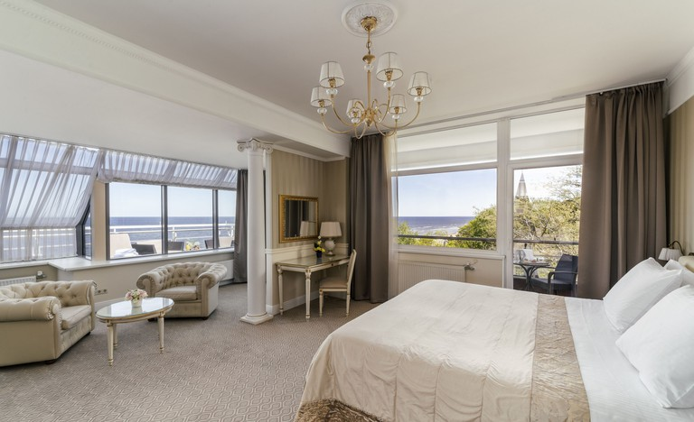 Baltic Beach Hotel elegant and spacious suite with tan colour scheme and large outdoor terrace with sea view