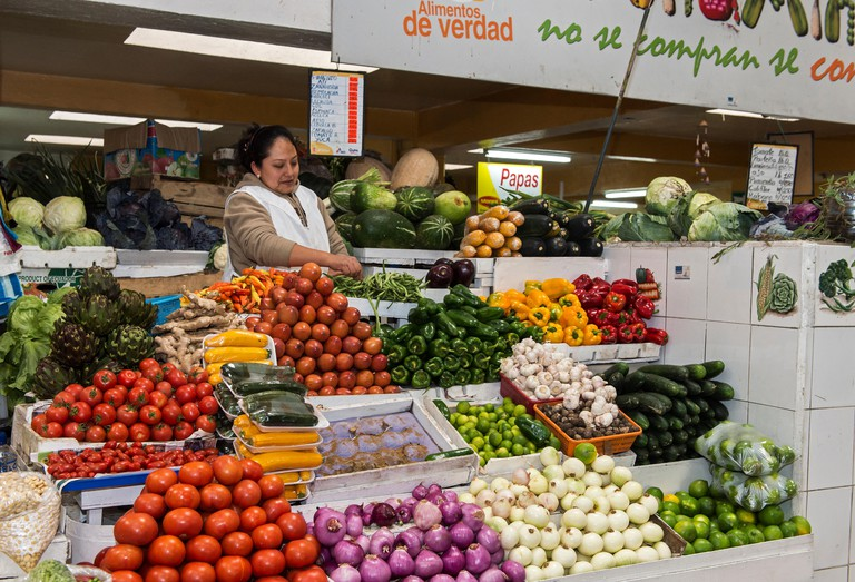 Vegetable stand at Inaquito Market food court, Quito, Ecuador