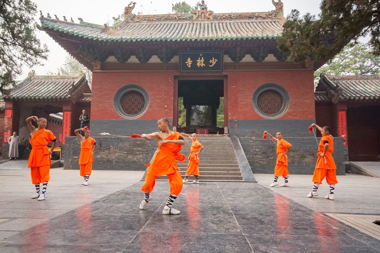 The group of Shaolin kungfu performs at Shaolin Temple in Dengfeng of Henan Province, China