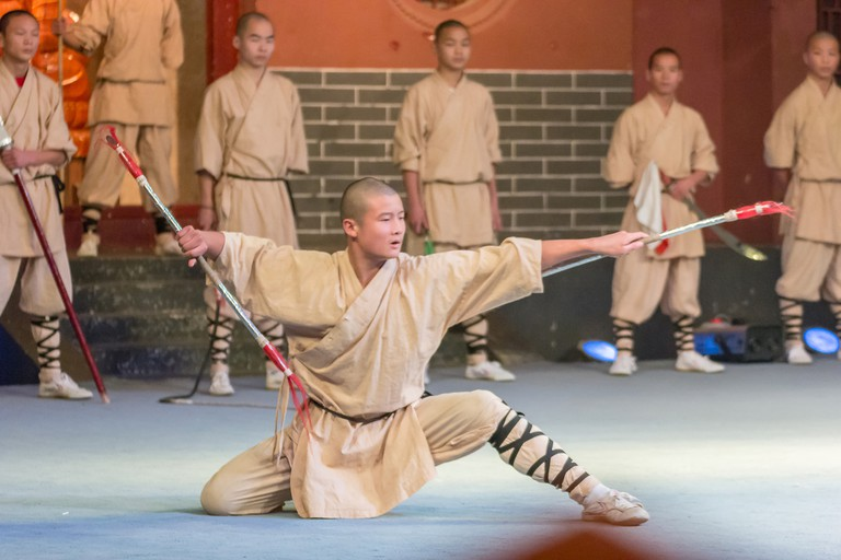Monk performs Chinese martial arts called Shaolin Kung Fu (Shaolin Wushu) at Shaolin Temple Monastery